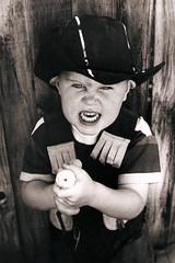 cowboy (sloanpix) Tags: cowboy gun stickemup guncontrol littlecowboy