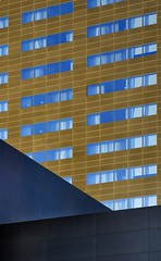 Blue Windows (Tom Haymes) Tags: windows austin w angles austintexas whotel abstractarchitecture downtownaustin brownbuilding bluewindows