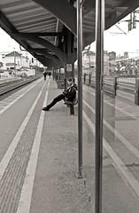 L1002278_v1 (Sigfrid Lundberg) Tags: man lund bench skåne sitting sweden platform sverige seated plattform zm bänk lundc track2 sittande spår2 lundcentralstation biogont235 lundscentral 35mmf20zmbiogon