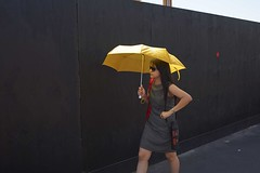 Yellow umbrella/red dot (peter burge) Tags: people girl umbrella person graphic candid streetphotography yellowandblack candidphotography girlwithumbrella distagont235 d700 zf2 zeiss35mmf2 peterburge