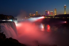 Niagara Falls by night (Rozanne Hakala) Tags: longexposure usa mist ny newyork canada tourism water skyline night reflections river outdoors niagarafalls dusk tourist falls spray illuminated coloredlights gorge bluehour naturalwonder powerful bridalveilfalls prospectpoint horseshoefalls americanfalls spotlights skylontower goatisland niagarariver rollingthunder thunderous lunaisland niagarafallsstatepark oldeststatepark rozannehakala