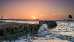 Dovercourt Dawn. (Tris1972 (tmorphewimages.co.uk)) Tags: morning sea sun lighthouse water sunrise canon dawn coast seaside spring warm waves coastal splash essex dovercourt harwich eastanglia efs1755f28