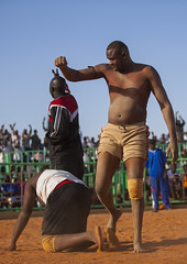 Nuba Wrestlers, Khartoum, Sudan (Eric Lafforgue) Tags: africa people motion men sport vertical outdoors photography referee day adult action northafrica muscle soedan wrestling sudan gesturing sunny competition victory dirt tournament winner wrestler strength tall activity aggression fighting khartoum adultsonly developingcountries traditionalculture skill soudan 3people vitality northernafrica realpeople capitalcities threepeople traveldestinations colorimage assertiveness onlymen fulllenght matureadult maturemen  szudn sudo  kordofan competitivesport northernsudan northsudan   incidentalpeople combativesport nubianwrestling   nativeafricanethnicity africantribalculture  xuan ert9616