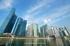 Singapore City Skyline 03 (yewkwangphoto) Tags: sea cloud seascape tourism water horizontal architecture landscape singapore asia cityscape bluesky tourist hotels banks skyscaper famouslandmark commercialbuilding placeofinterest modernbuildings modernstructure buildingstructure singaporecityskyline photocategory yewkwang photographybyyewkwang