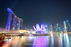 Marina Bay Sand 04 (yewkwangphoto) Tags: sea seascape water horizontal museum architecture skyscraper reflections shopping landscape singapore cityscape bluesky tourist nightscenery placeofinterest commercialbuildings buildingstructure marinabaysands laserdisplay photocategory yewkwang artsciencemuseum thehelixbridge photographybyyewkwang
