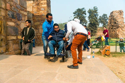 Accessible Tour of Qutub Minar: Planet Abled volunteers assisting the wheelchair user at Qutub Minar.