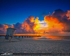 Rain Clouds Illuminate Pompano Beach Pier Square (Captain Kimo) Tags: aurorahdr2017 browardcounty captainkimo hdrphotography pompanobeach pompanobeachpier clouds lifeguardtower sunrise