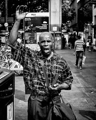 Evangelium (thomasthorstensson.photography) Tags: story sunny composition face fujifilmxt1 street social chaos streetphotography local 2016 day explore brixton xf23mm14r preacher summer urban monochrome london candid honest alone august eyes communication searching human station preaching