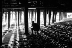 The Light Beneath the Pier (Geraint Rowland Photography) Tags: bw photographer photography blackandwhite blackandwhitephotography scene streetphotography beachphotography santamonicapier usa geraintrowlandphotography shadows lightplay lightanddark smokey atmosphericphotography candidportraitofaphotographer sand sea ocean sunset lastlight theimportanceoflight