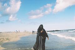 Cell phones go everywhere (andrewkatchen) Tags: asburypark newjersey jerseyshore beach ocean nikon film 35mm portra400 n6006