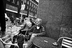 Lost in Thoughts (Steve Lundqvist) Tags: bw black white poor drunk beer bar local locale pub street homeless berlin berlino germany german deutschland monochrome lost sidewalk downtown bottle wine povero barbone alcool alcohol addiction rehab drug