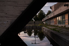 It's all in the reflection (modestmoze) Tags: 2016 500px lithuania vilnius city concrete reflection sky clouds outside outdoors girl shadows grass trees crane windows lines history old one brown white blue black red glass wood covered water abandoned