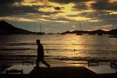 2009 (SpyrosCatPhotography) Tags: sunset sea sky people man