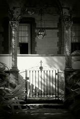 Gate (kellyhughes1970) Tags: blackandwhite bw sun digital garden gate unitedstates florida porch lantern pillars staugustine flaglercollege nikond80
