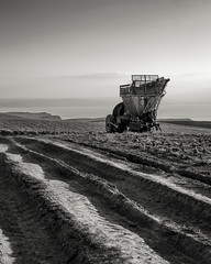 idle (SJLens) Tags: bw white black 35mm mono cornwall farm farming tracks machinery tyres bude sandymouth tyretracks farmlife farmmachinery d5100 nikond5100