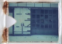 AIR (abdukted1456) Tags: door ny newyork building abandoned lines polaroid grid closed decay garage air crumbling expiredfilm landcamera 669 packfilm instantfilm type669 peelapart speigletown automatic420