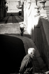 [ perpendicular lifes ] ([ chang ]) Tags: street people bw italy white black blanco person calle strada italia negro noto bn sicily bianco nero sicilia streetshot wwwriccardoromanocom
