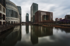 Dull Reflections (www.paulshearsphotography.com) Tags: road longexposure bridge homes winter light reflection water architecture docks work buildings daylight high bright path smooth bank business flats cc adobe lee wharf tall canarywharf dlr citigroup banks offices finance citi heronquays jpmorgan morganstanley cliffordchance heronquay colorefex 10stop 10upperbankstreet niksoftware mackenziewalk bigstopper cliffordchancellp leebigstopper lightroom4 nikcolorefex4 colorefex4 adobelightroom4 nutraldenstiy nutraldenstiyfilter