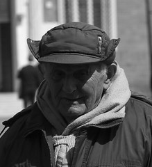 Looking 16 (Baz 120) Tags: street portrait blackandwhite bw italy faces candid streetphotography unposed g3 45mm decisivemoment candidportrait mft primelens candidstreet grittystreetphotography
