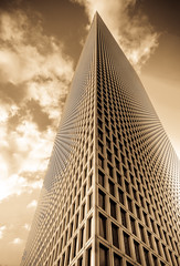 reaching beyond the clouds (amira_a) Tags: skyscraper sepia clouds tallbuilding building d5100 nikon sigma 1020mm wideangle upward detailsenhancer azrieli telaviv israel