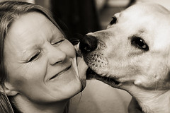 Affection (magnusl67) Tags: blackandwhite woman dog animals female kiss affection sweden jmtland stersund canoneos50d magnuslgdberg