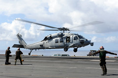A helicopter lands on the flight deck. (Official U.S. Navy Imagery) Tags: heritage america liberty freedom commerce unitedstates military navy sailors fast pacificocean worldwide tradition usnavy protect deployed flexible onwatch beready defendfreedom warfighters nmcs chinfo sealanes warfighting preservepeace deteraggression operateforward warfightingfirst navymediacontentservice