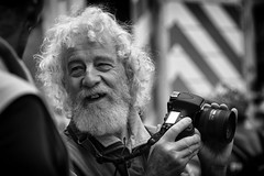 The Happy Photographer (Just Ard) Tags: man beard whiskers camera photographer people person face street photography candid unposed black white mono monochrome bw blackandwhite noiretblanc biancoenero schwarzundweis zwartwit blancoynegro  justard nikon d750 85mm