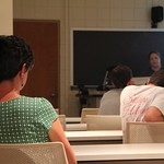 A professor listening to a students presentation