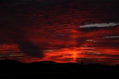 Light pillar /  (nzom) Tags: sunset red clouds pillar