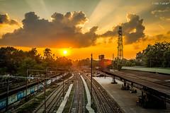 Sunshine (reazd7100) Tags: sunset dusk station train rays light cloud
