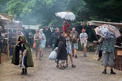 Medieval market in rain (stenaake) Tags: market medieval rain people visby gotland sweden week festival umbrella