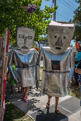 We Are the Robots (Facundity) Tags: albuquerque offcenterfolkartfestival albuquirky newmexico papiermch papermache folkart costumes masks upcycled creativeart inapark streetphotography vibrant joyful robots silver