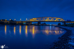 Passing ship (Robert Stienstra Photography) Tags: bridge bridges dutchbridges blue hour bluehour bluehourphotography riverscape dutchriver westervoort longexposure longexposurephotography landscape landscapes dutchlandscapes outdoor nikond7100 tamron18200mm nightscapes cityscape cityscapes reflection reflections
