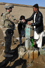 Airmen and Afghan well mission