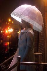 (AlexandraGalvis) Tags: light ballet film girl rain night umbrella canon movie lights dance student whimsy traffic post turquoise girly coat profile skirt rainy nightime blonde raindrops dreamy dreamlike cinematic raining tulle nightwinter filmshort tulledress
