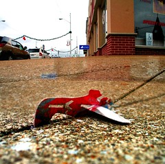 paper planes (photograph-e) Tags: christmas street trash plane canon toy found eos rebel xt downtown stitch random crashed crack litter sidewalk 2012 paperplane
