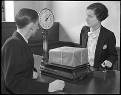 Female postal clerk (British Postal Museum & Archive) Tags: postoffice scales customer parcel cannonstreet clerk postofficecounters