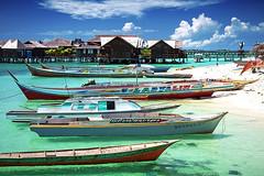 Mabul (Mathijs Buijs) Tags: sea beach water canon boats island eos boat asia village filter malaysia borneo 7d tropical polarizer sipadan sabah mabul polarizing semporna