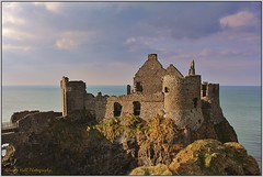 Dunluce In The Sunshine (Glenda Hall) Tags: ocean ireland sea sky sunlight building castle water canon landscape dangerous ancient ruins rocks shadows cliffs april northernireland portrush antrim northcoast dunluce dunlucecastle coantrim portballintrae 2013 canon60d glendahall