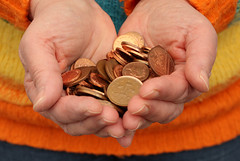 Handful of coins (Helen in Wales) Tags: orange hands coins copper loosechange handful