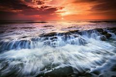 the last defender (Mk Azmi) Tags: ocean morning light sea sky cloud sun motion beach nature water rock sunrise flow bay slow wave images lee malaysia shutter getty terengganu teluk dungun gnd kalong singhray reversegnd