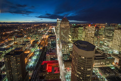 from Calgary tower to the west - 20 mins after (tuanland) Tags: road lighting street city winter snow canada building calgary architecture night twilight nikon downtown cityscape nightscape traffic wide perspective wideangle alberta bluehour calgarytower downtowncalgary d600 nikond600 longexploser