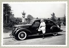 1937 Lincoln Zephyr (Raymondx1) Tags: vintage classic black white blackwhite sw photo foto photography automobile car cars motor lincoln zephyr lincolnzephyr lincolnv12 sedan 1930s thirties woman lady blonde whitewalltyres whitesidewalltires whitewalls fashion ridingcrop whip ridingboots tie breeches park garden