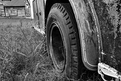 Flat Tire Black & White Blues (BKHagar *Kim*) Tags: red blackandwhite bw monochrome wheel truck vintage mono cabin rust flat antique background rusty tire firetruck logcabin rusted vehicle fireengine limestonefleamarket bkhagar