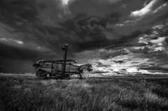Moving On To Greener Pastures (Stubble Jumper Photography) Tags: alberta abandoned prairie threshingmachine thrashingmachine clouds storm