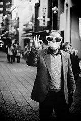 Everything's O.K. (Nishi Drew) Tags: street portrait people bw dog white black monochrome japan contrast canon person 50mm bokeh candid 14 kobe  shallow kansai motomachi ff      5dii canon5dmarkii