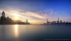 Victoria Harbour (mendowong) Tags: longexposure light sunset sky hk cloud motion water lines reflections landscape photography hongkong golden photo timelapse movement bright time sony wide sigma stack colourful streaks ultra a57 816mm mendowong
