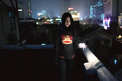 Kinki (HIKARU Pan) Tags: light portrait woman rooftop girl night standing scarf outdoors photography asia shanghai fireworks chinese chinesenewyear youngwoman china1 35l canonef35mmf14lusm 5d2