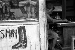 The Shoemaker (Alexander Ipfelkofer) Tags: old blackandwhite bw man work indonesia shoe candid poor streetphotography yogyakarta hardship centraljava
