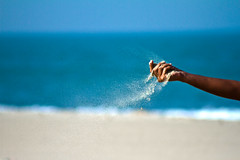 The sands of time (Tahseen Maugham) Tags: ocean blue sea sky beach beautiful canon eos fly sand perfect hand time freeze hour flies moment sands hourglass
